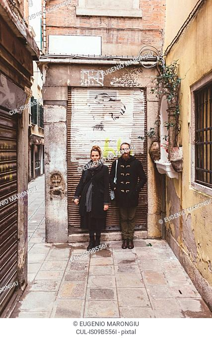 Portrait of couple on street, Venice, Italy