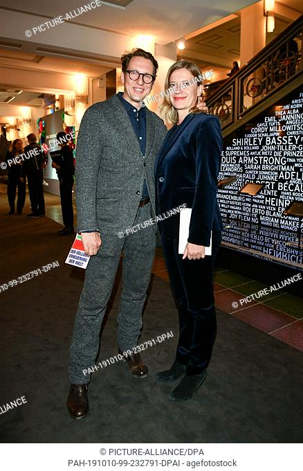 """09 October 2019, Berlin: Caroline Peters and her friend Frank Dehner come to the premiere of """"""""Faith in the Possibility of the Complete Renewal of the World""""""""..."""
