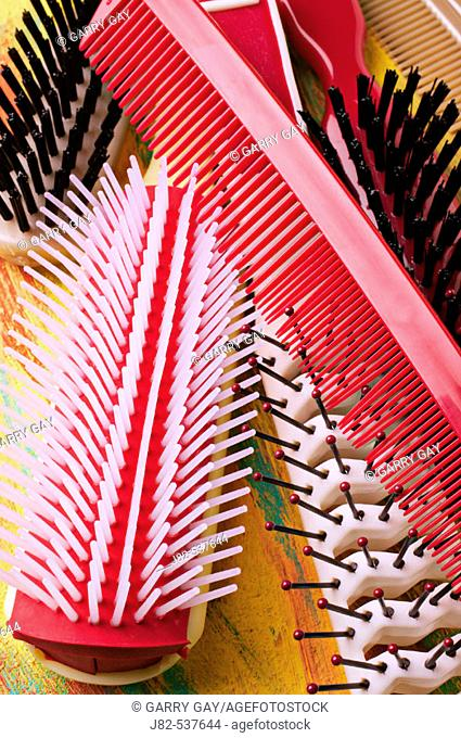 Pile of brushes with red comb