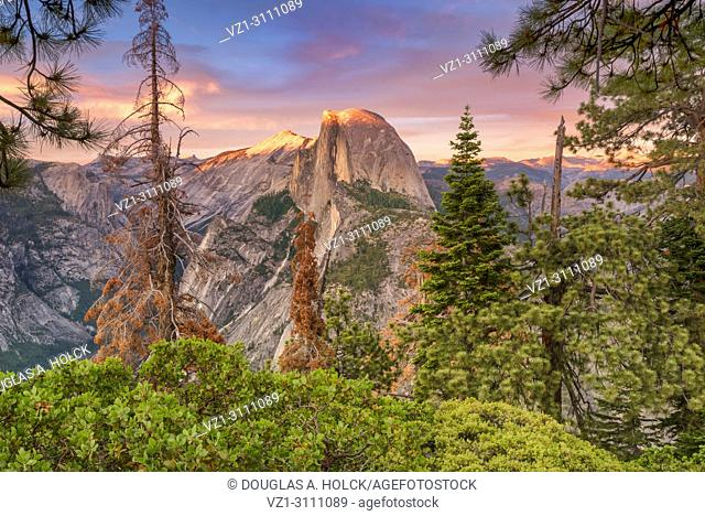 The colors of sunset on Half Dome on a warm summer evening in Yosemite NP, USA