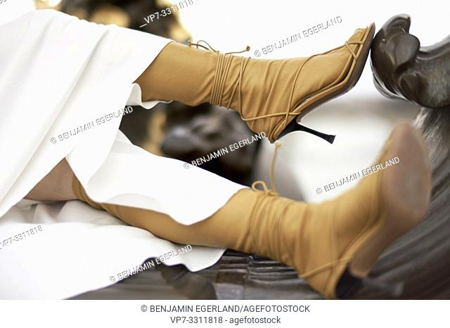 shoes of fashionable blogger woman, latest fashion trends during fashion week, in city Paris, France