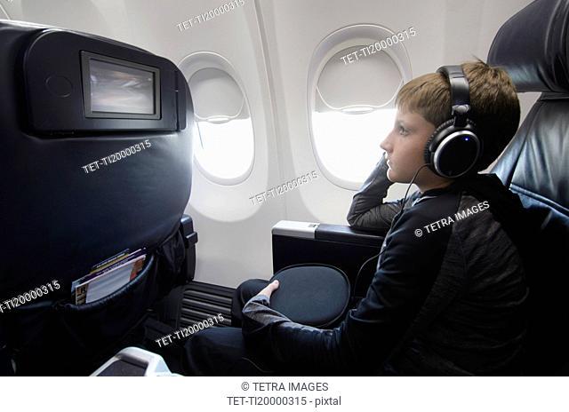 Boy watching tv in aero plane