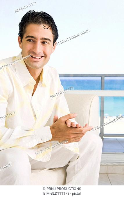 Caucasian man sitting in armchair