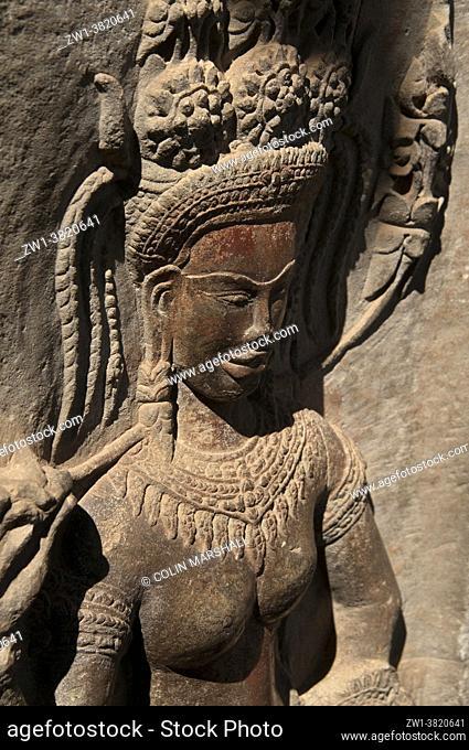 Carving of apsara dancer with original color, Angkor Wat temple, Siem Riep, Cambodia