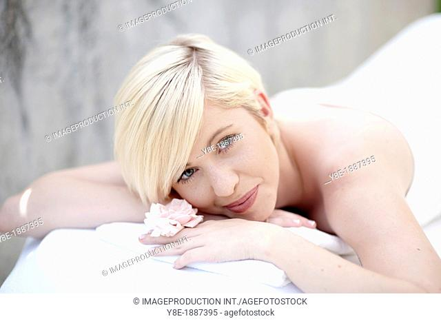 Czech Republic, Young woman lying on front in SPA