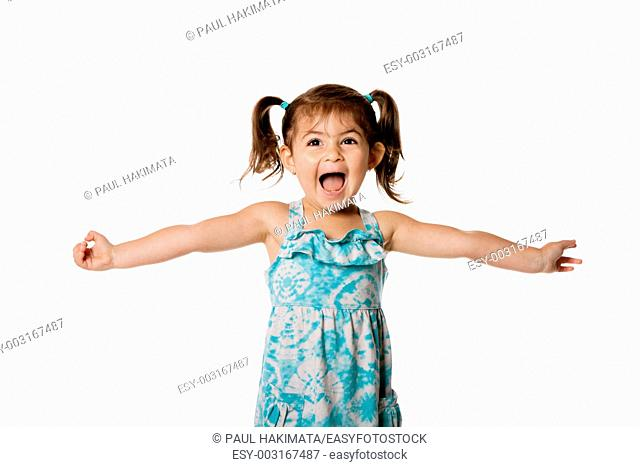 Cute beautiful funny ecstatic happy little toddler girl celebrating with open arms, isolated