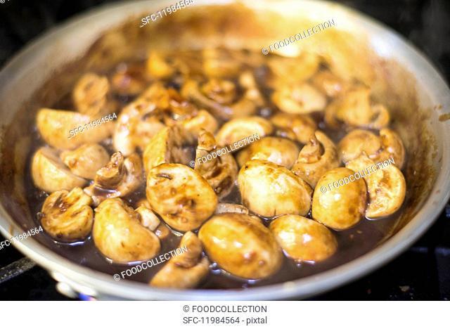 Braised mushrooms in a frying pan