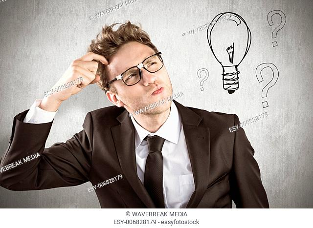 Composite image of young geeky businessman scratching his head