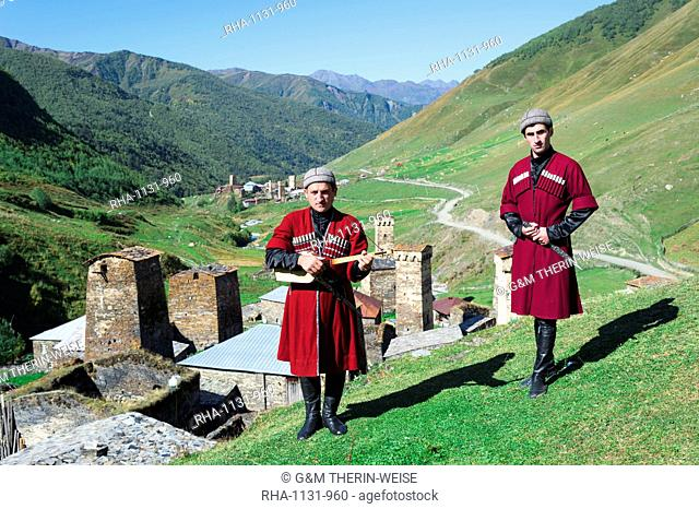 Georgian musicians in folkloric dress holding Panduri instrument and dagger, Ushguli, Svaneti region, Georgia, Central Asia, Asia