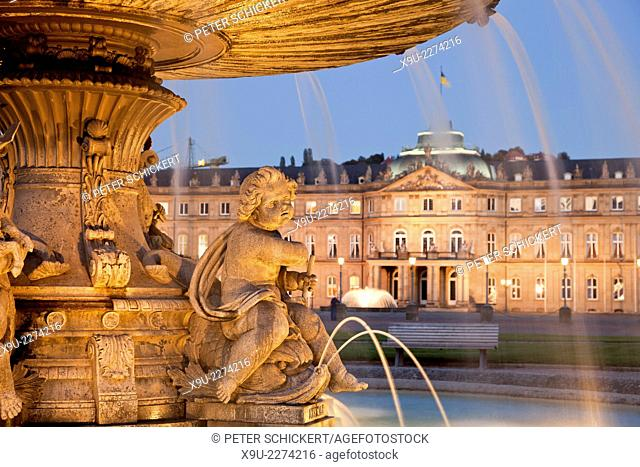 fountain on Schlossplatz square and the New Palace in Stuttgart at night, Baden-Württemberg, Germany, Europe