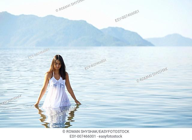 Beautiful woman in a tranquil sea