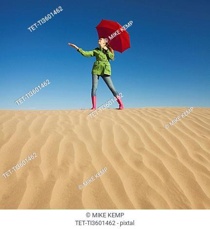 Woman waiting for rain in the desert