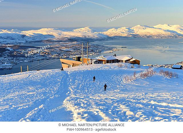 View from above to the summit station from Fjellheisen cableway on the mountain Storsteinen with Tromsø in the distance, 6 March 2017 | usage worldwide