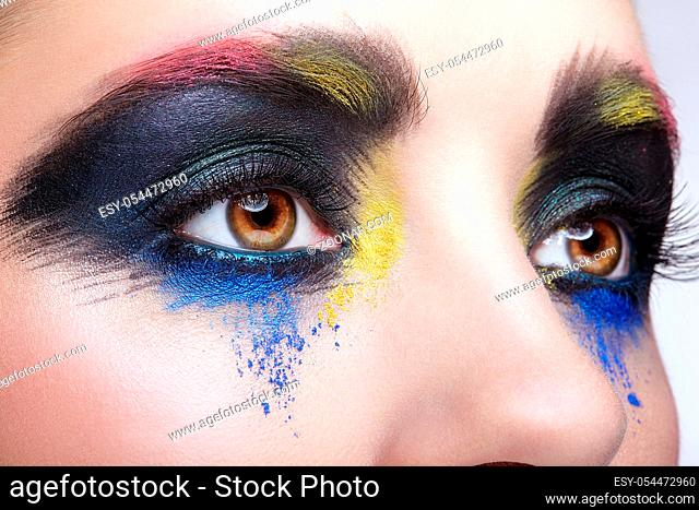 Close-up macro portrait of beautiful woman eye zone make up. Female eye with unusual artistic painting makeup