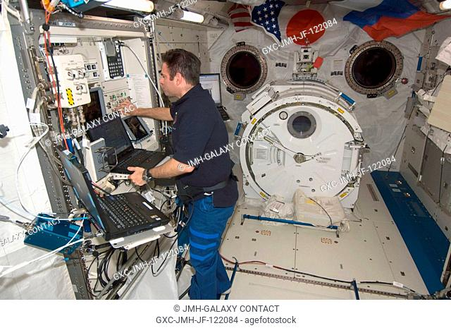 NASA astronaut Greg Chamitoff, Expedition 17 flight engineer, works at the Japanese Remote Manipulator System (JEM-RMS) work station in the Kibo laboratory of...