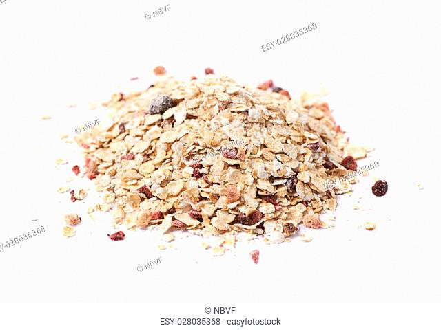 Pile of oatmeal groats porridge mixed with dried fruit pieces, composition isolated over the white background
