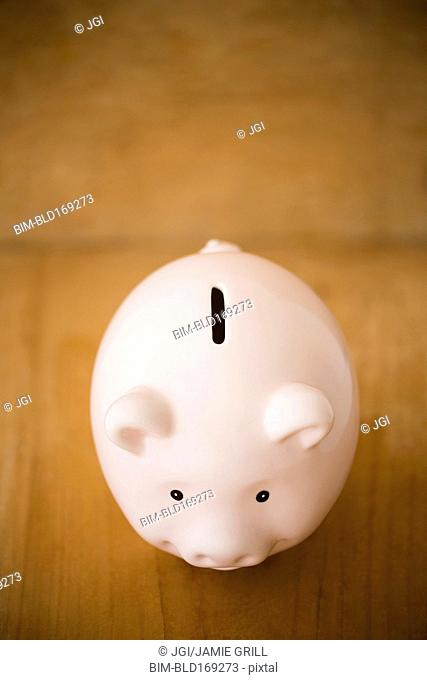 Close up of piggy bank on table