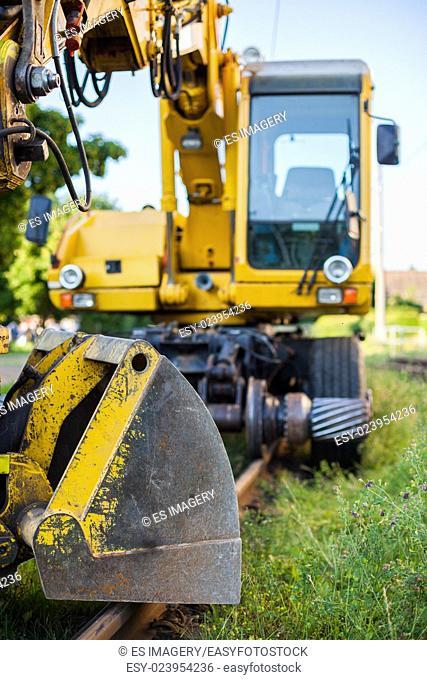 Railway construction equipment including hyralic shovel on rails