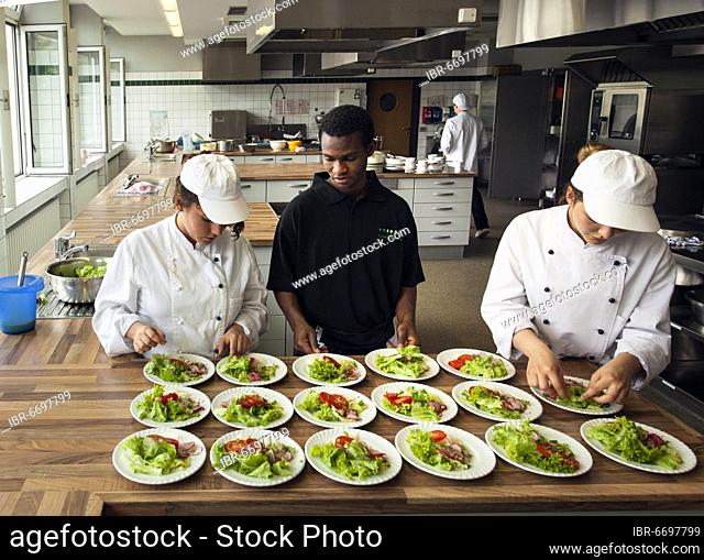 Canteen kitchen in a vocational college in Düsseldorf, trainees manage the school's catering as part of their training, trainees prepare salad plates