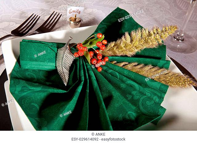 Detail of a festive table with green holiday napkins