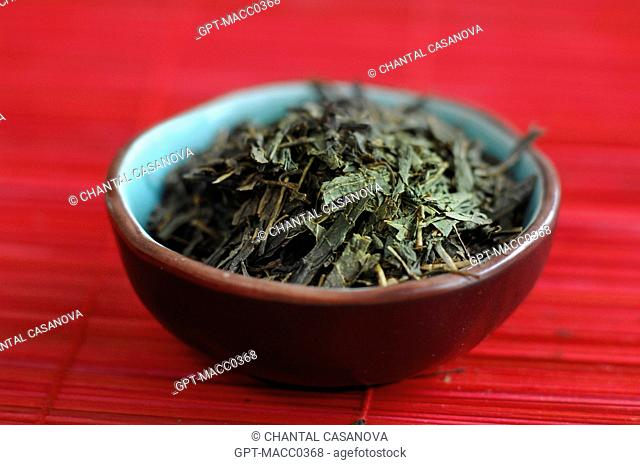 LEAVES OF ORDINARY JAPANESE GREEN TEA SENCHA IN A BOWL CHAWAN, TEA WITH A TASTE OF SEAWEED OR GRASS, WIDELY DRUNK IN JAPAN