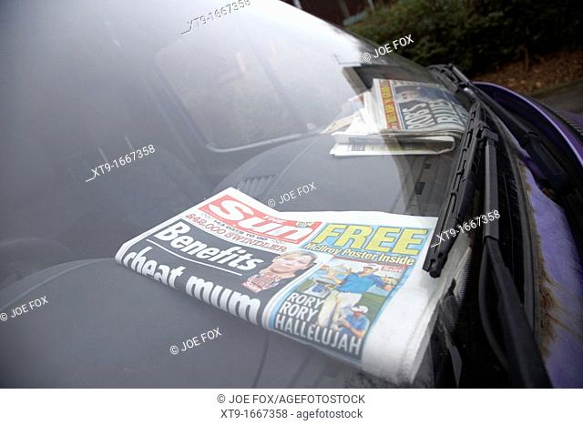 the sun newspaper on the dashboard of a parked workmans van in Belfast Northern Ireland UK