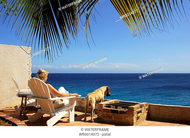 Tourist an Dog enjoys View, Caribbean Sea, Netherland Antilles, Curacao