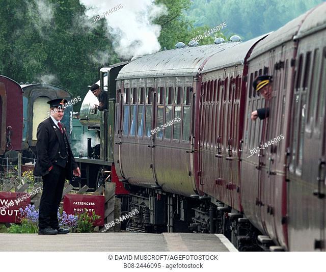 The vintage steam locomotive Lord Phil is prepared for service at Peak Rail's heritage railway station platform. Matlock,Derbyshire,Britain