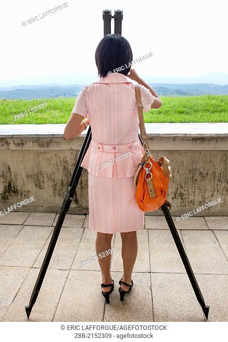 North Korean Woman Looking At South Korea From The Wall Section, Dmz, Panmunjom, North Korea
