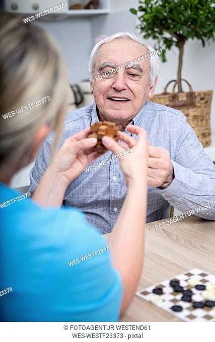 Gereatric nurse doing dexterity games with elderly patient