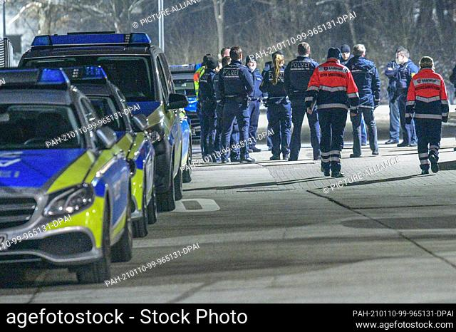 10 January 2021, Baden-Wuerttemberg, Ellwangen: Dozens of police and rescue vehicles are parked at the initial reception facility for refugees (LEA) in...