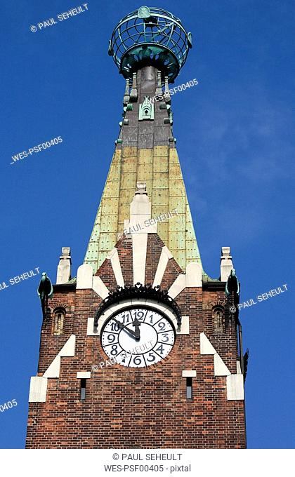 Poland, Cracow, Pyramidal Clock tower and globe of Globe House