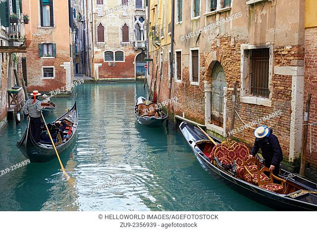 Gondoliers on their decorative gondolas on side canals, Venice, Veneto, Italy, Europe