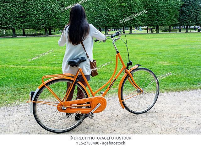 Copenhagen, Denmark, Woman with Bicycle in Public Park Scene, King's Garden, Kongens Have
