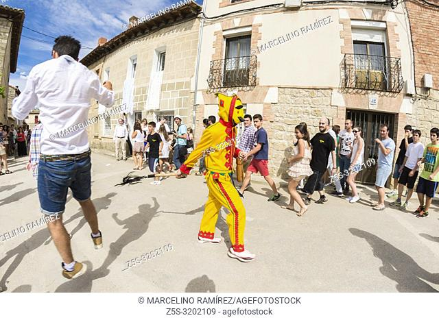 El Colacho chases the village youngsters with his whip during the Fiesta del Colacho in Castrillo de Murcia, Burgos, Castilla y Leon, Spain, Europe