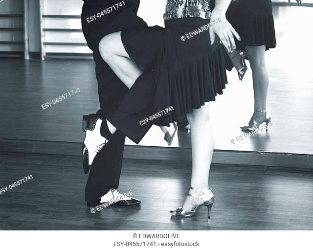 Ballroom dance couple of dancers and teachers in studio school dancing in rehearsal