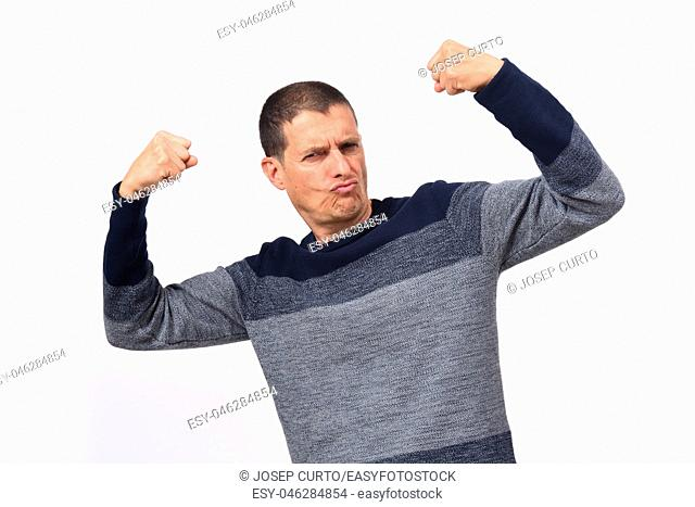 Man raising his arms making biceps and sign of victory and strength