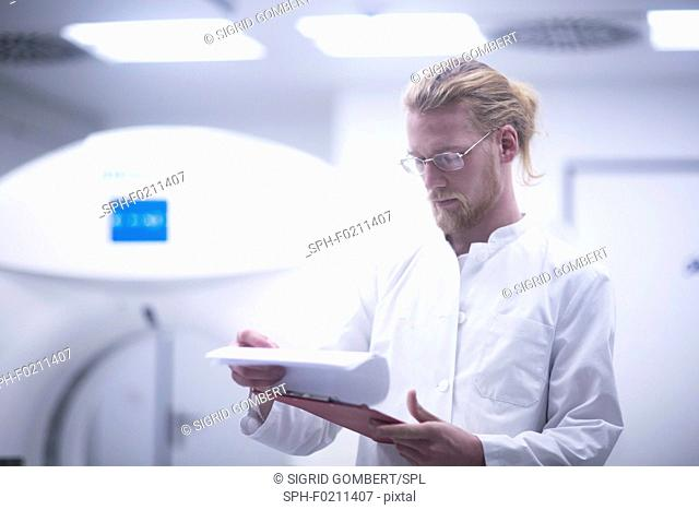 Radiologist checking notes