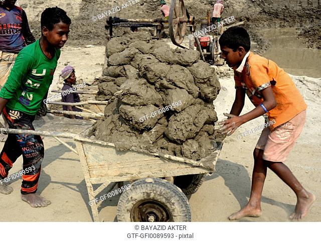 Two Bangladeshi child workers are taking clay for break field use in Keraniganj