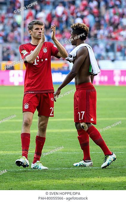 Munich's Thomas Mueller (L)and David Alaba walk across the pitch after the German Bundesliga soccer match between Bayern Munich and Borussia Moenchengladbach...