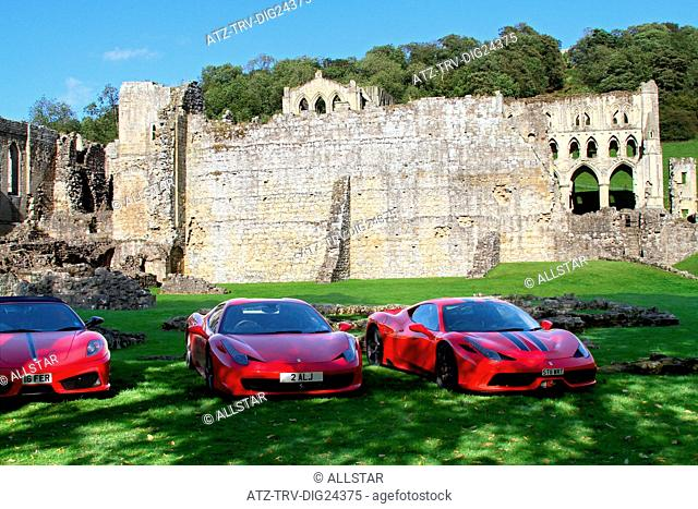 RED FERRARI 458 SPIDER, 458 SPECIALE CARS; RIEVAULX ABBEY, NORTH YORKSHIRE, ENGLAND; 30/08/2014