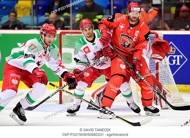 From left hockey players SAM JARDINE, BRYCE REDDICK, both of Cardiff and RADEK SMOLENAK of Hradec Kralove in action during the Champions Hockey League H group...