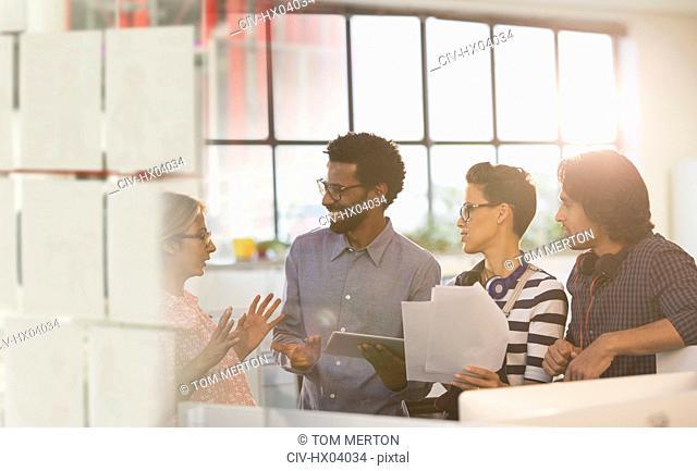 Smiling creative business people brainstorming in office meeting