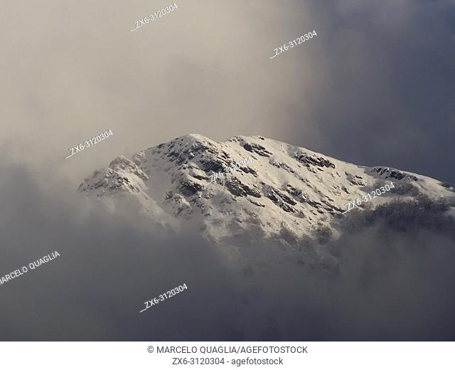 Les Agudes Peak after snowfall within clouds. Wintertime at Montseny Natural Park. Barcelona province, Catalonia, Spain