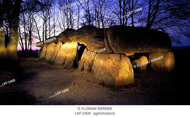 Dolmen between trees in the evening light, Ille et Villaine, Brittany, France