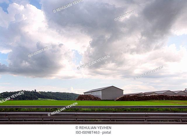 Landscape with agricultural buildings and stacked logs, Francenigo, Veneto, Italy