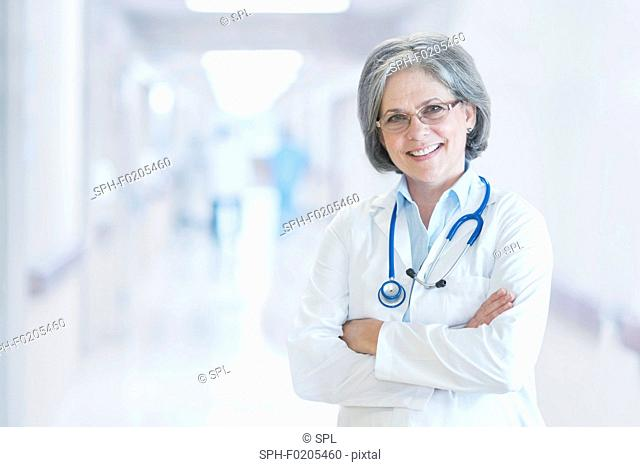 Mature female doctor smiling