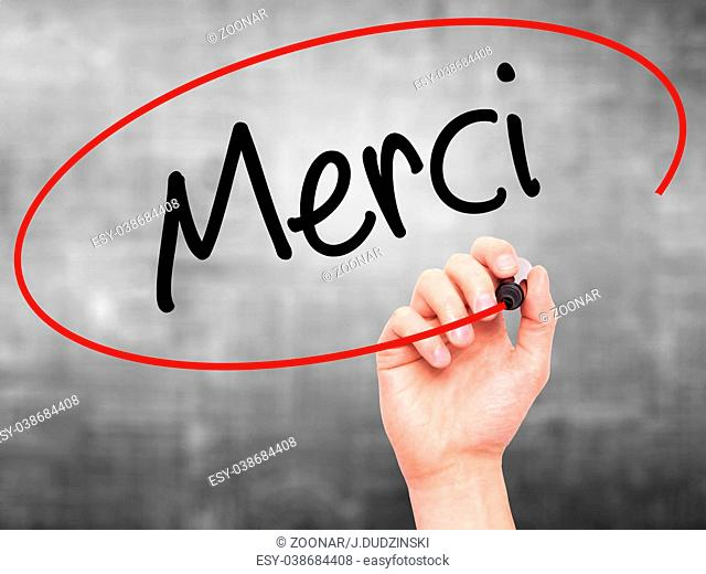 Man Hand writing Merci (Thank You In French) with black marker on visual screen