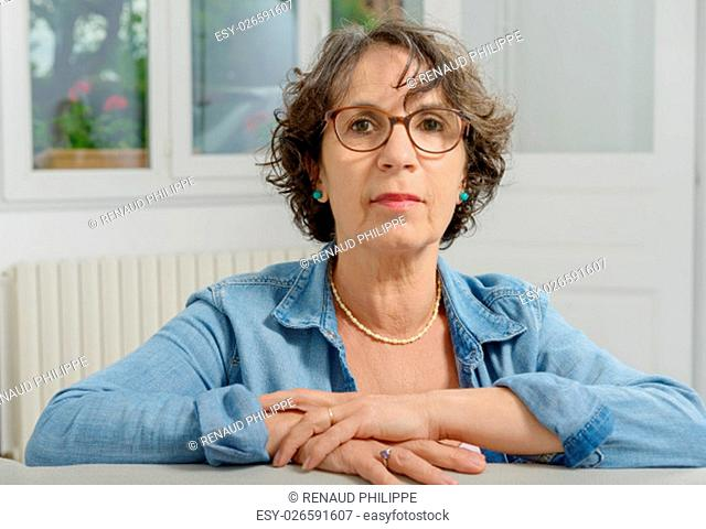 portrait of beautiful middle-aged woman with eyeglasses
