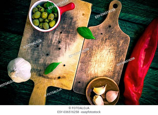 Old chopping boards with spices and herbs